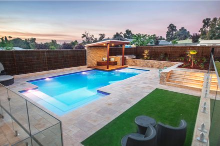Backyard garden lanscaping with a swimming pool